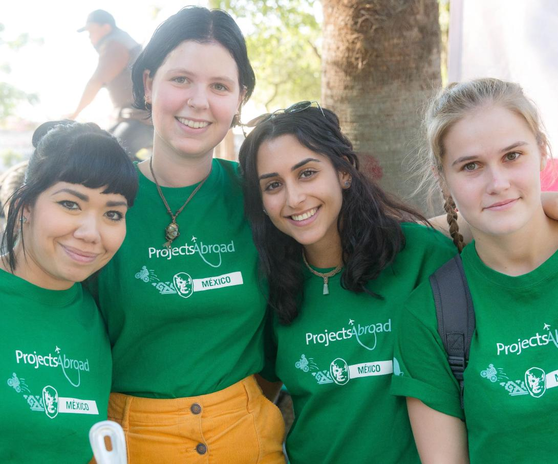 A group of volunteers in Mexico take a photo together before participating in a feeding programme.